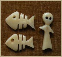 Bone amulets by Lamollesse