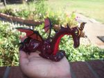 Red Dragon holding Garnet by fierceshetland