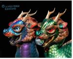 Sun and Moon dragon  heads by Reptangle
