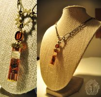 Robotic Sustenance Oil Vial - on 22 in brass chain by kerinewton