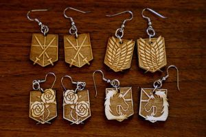-Etsy- Attack on Titan Insignia Earrings by Nortiker