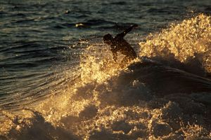 Surfer in spray - Byron Bay by wildplaces