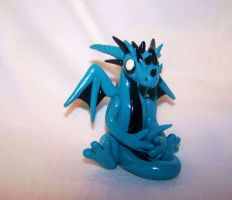 Blue cartoon dragon sculpture by ByToothAndClaw