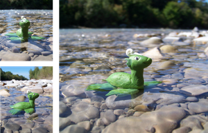Water dragon swimming in a river by Aberhavre