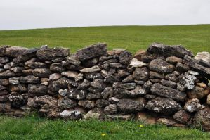 Grassy hilltop and old wall by Georgina-Gibson