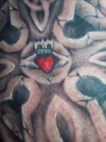 close up of claddagh in cross by hatefulss
