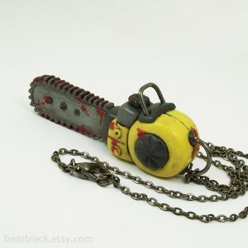 Bloody Chainsaw Necklace by beatblack