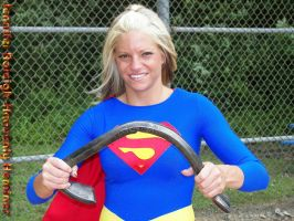 supergirl bends a steel bar by ilikesuperwomens