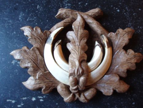 Shield for wild boar teeth by woodcarve