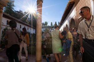 Alhambra Guide and Tourists by Coquin