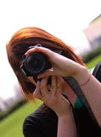 Her DSLR by Buaha