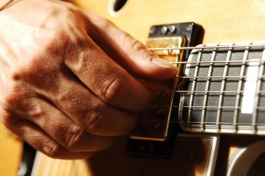 Guitar Close-up 6140450 by StockProject1