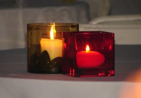 Two Red Gold Burning Candles by FantasyStock