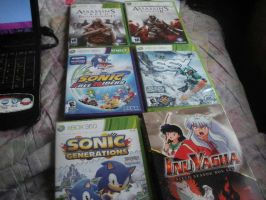 Look at my games and dvd. by BlueRosePetalsQueen
