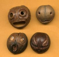 nut hull face pendants by DonSimpson