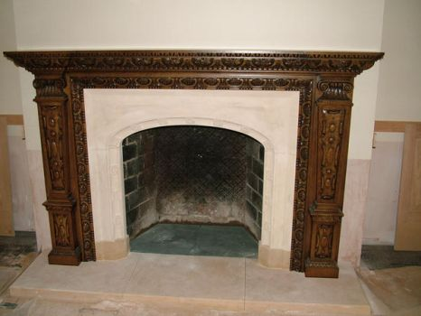 hand carved fireplace by timpeekwoodcarving