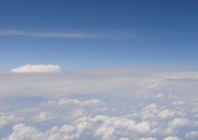 Airplane Above Puffy Clouds 07 by FantasyStock