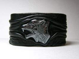 Leather Cuff with Carved hematite wolf head by leatherjewelry