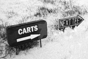cart and next tee sign on a snow covered golf cour by morrbyte