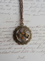 Stempunk necklace with small bow and gears by SteamJo