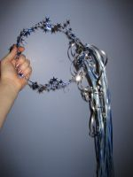 Hand w Sparkly blue streamers by SerendipityStock