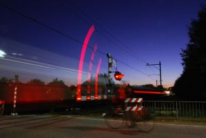 train passing by at night by RichardRH