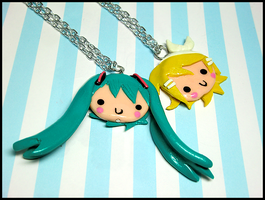 Miku + Rin Necklaces by GrandmaThunderpants