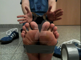 Handcuffed hands, tapetied feet, ready for you. by SneakerBoyBondage