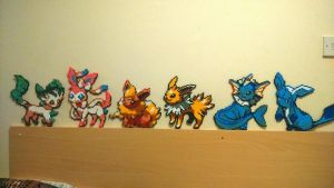 8 Bits and Pieces: Eeveelutions by Starlight2011studios