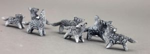 Pack of tiny wolves by hontor