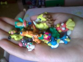 many pokemon in a hand by Debyvip