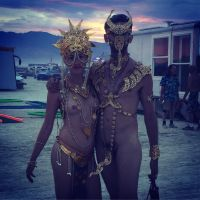 Straight couple in gold at burning man 4 by TheMaleNudeStock