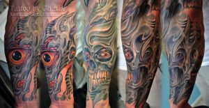 Half sleeve Biomech tattoo by gettattoo