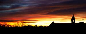Sunrise behind the church by 06footnerc