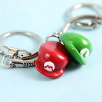 Mario and Luigi hat keychains by TrenoNights