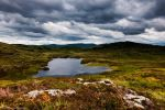 The clouds hang heavily over the heart shaped loch by LordLJCornellPhotos