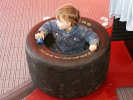 KID IN A TIRE by CharlesNissen