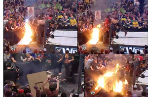 Edge SPEARS Mick Foley throught a fire table by edge4923