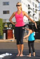 Stacy Keibler with tiny yoga instructor by SizeExchange