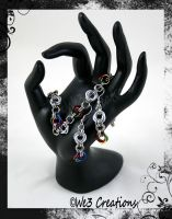 Holiday Cheer Mobius Flower Bracelet and Earring by kelleejm1