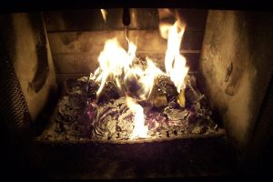 Glowing ashes in the fire by paintresseye