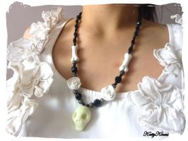 Creepy Skull Necklace by Cateaclysmic