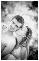 Portrait of young beautiful couple in love by ngkamarasev