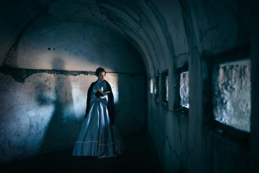 Woman in victorian dress imprisoned in a dungeon by Black-Bl00d
