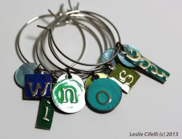 Enameled Embossed Brass and Shell Wine Charms by Ironmountain01