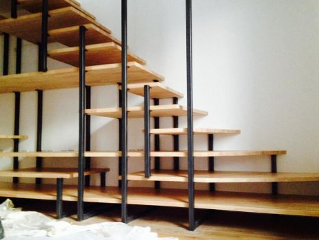 Iron and wood stairs and bookcase... by ironwelding