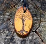 Black tree white tree oval pendant by sleepyhamsteri