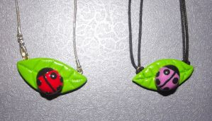 Ladybird necklaces by MeticulousBlue