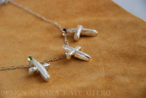 -Donna- pearl cross necklaces by Dwelian