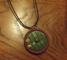 Hobbit-hole door necklace by MeticulousBlue